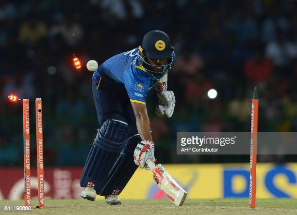 Sri Lankan cricketer Kusal Mendis is run out during the fourth one day international cricket match between Sri Lanka and India at R Premadasa Stadium...