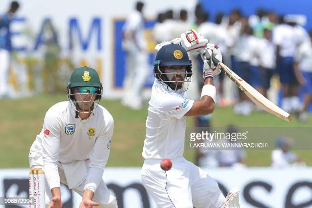 Sri Lankan cricketer Kusal Mendis is watched by South African cricketer Aiden Markram as he plays a shot during the first day of the opening Test...