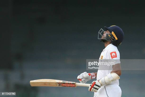 Sri Lankan cricketer Kusal Mendis looks up above after scoring 50 runs during the 4th day's play in the only Test match between Sri Lanka and...