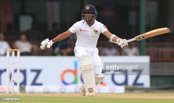 Sri Lankan cricketer Kusal Mendis shouts to avoid a run out during the first day's play of the second test cricket match between Sri Lanka and New...