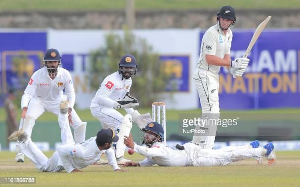 Sri Lankan cricketer Kusal Mendis tries to complete a catch as Dhananjaya de Silva Niroshan DickwellaLahiru Thirimanne react while New Zealand...