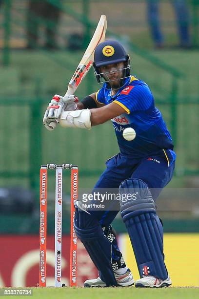 Sri Lankan cricketer Kusal Mendis watches the ball as he plays a shot during the 2nd One Day International cricket match between Sri Lanka and India...