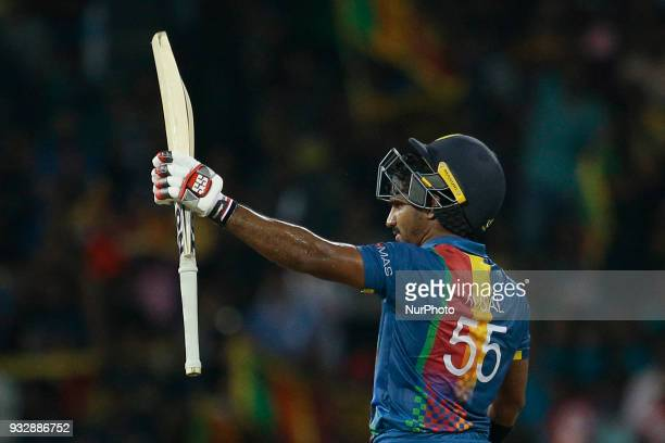 Sri Lankan cricketer Kusal Perera celebrates after scoring 50 runs during the 6th T20 cricket match of NIDAHAS Trophy between Sri Lanka and...