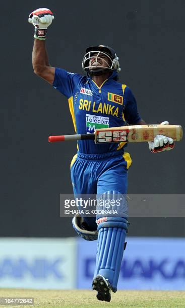Sri Lankan cricketer Kushal Janith Perera celebrates his half-century during the third and final one-day international match between Sri Lanka and...