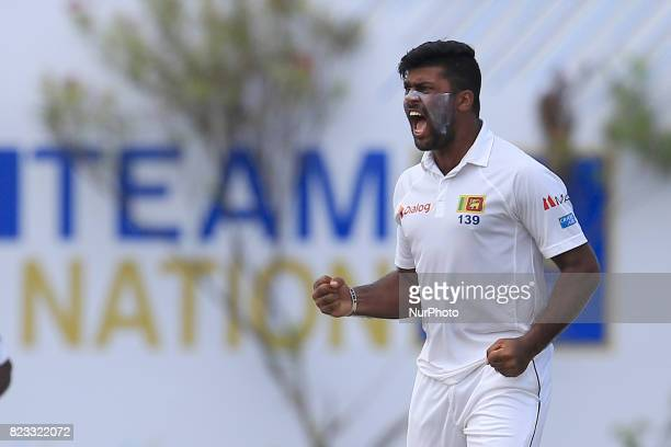 Sri Lankan cricketer Lahiru Kumara celebrates during the 2nd Day's play in the 1st Test match between Sri Lanka and India at the Galle International...