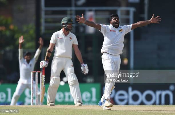 Sri Lankan cricketer Lahiru Kumara successfully appeals for a Leg Before Wicket decision against Zimbabwe's cricketer Craig Ervine during the first...