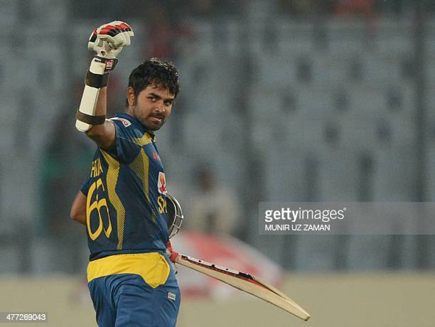 Sri Lankan cricketer Lahiru Thirimanne reacts after scoring a century during the final match of the Asia Cup oneday cricket tournament between...