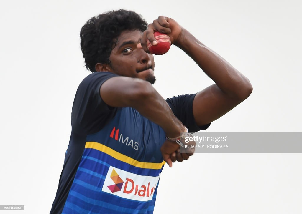 Sri Lankan cricketer Lakshan Sandakan delivers a ball during a practice session at The P. Sara Oval Cricket Stadium in Colombo on March 14, 2017. Bangladesh play their 100th Test on March 15, against Sri Lanka at The P. Sara Oval Cricket Stadium in Colombo. / AFP PHOTO / Ishara S. KODIKARA