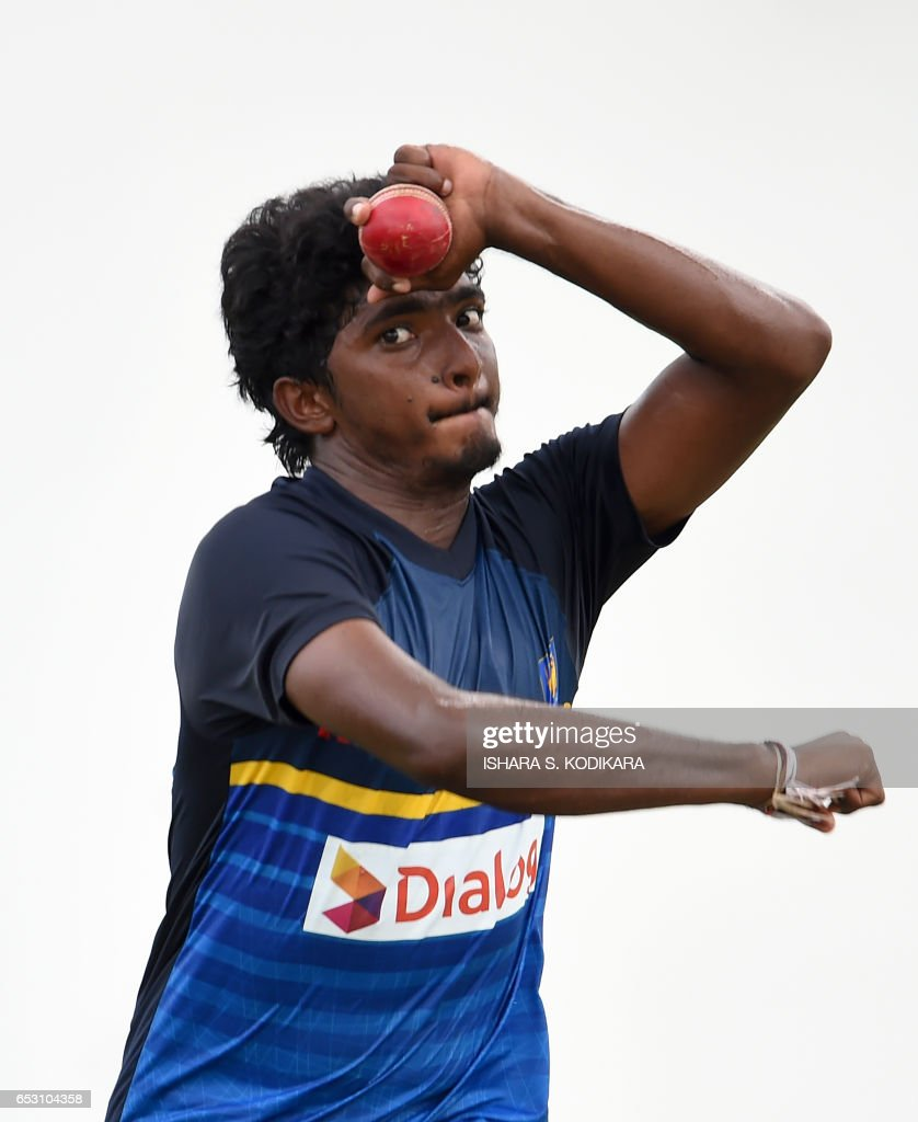 Sri Lankan cricketer Lakshan Sandakan delivers a ball during a practice session at The P