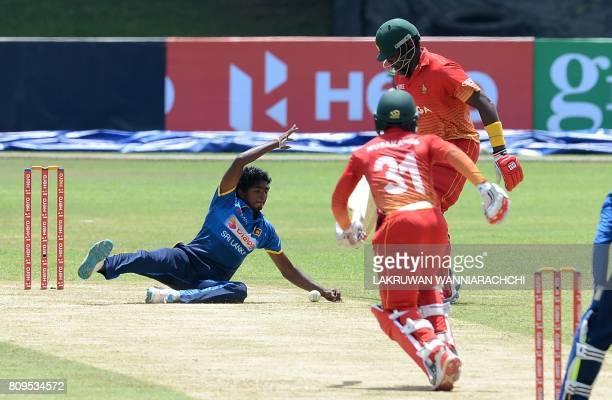 Sri Lankan cricketer Lakshan Sandakan dives as he attempts to field a ball hit by Zimbabwe cricketer Tarisai Musakanda during the third oneday...
