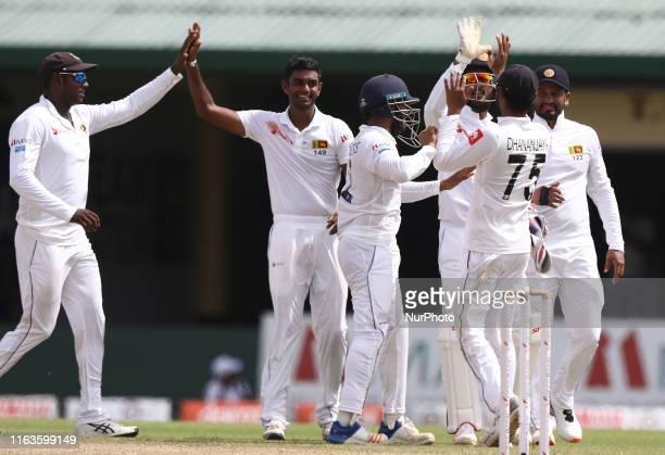 Sri Lankan cricketer Lasith Embuldeniya celebrates with Angelo Mathews Kusal MendisDhananjaya de Silva Dinesh Chandimal and Sri Lankan cricket...
