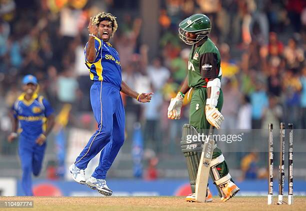 Sri Lankan cricketer Lasith Malinga celebrates after dismissing Kenya's cricketer Shem Ngoche during the Group A match in the World Cup Cricket 2011...