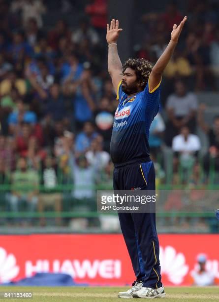 Sri Lankan cricketer Lasith Malinga celebrates after he dismissed Indian cricket captain Virat Kohli during the fourth one day international cricket...