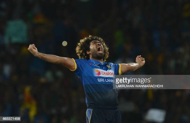 Sri Lankan cricketer Lasith Malinga celebrates taking the hat trick wicket to dismiss Bangladesh cricketer Mehedi Hasan during the second T20...