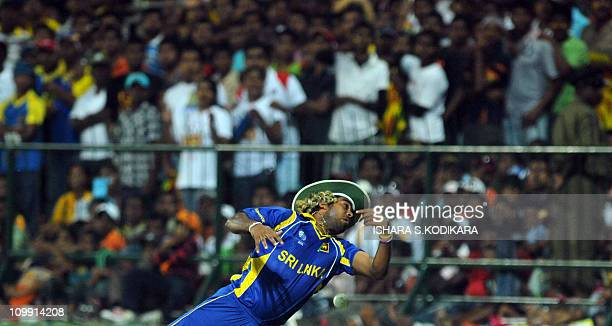 Sri Lankan cricketer Lasith Malinga drops catch from Zimbabwe's Brendan Taylor during the Group A match in the World Cup Cricket tournament between...