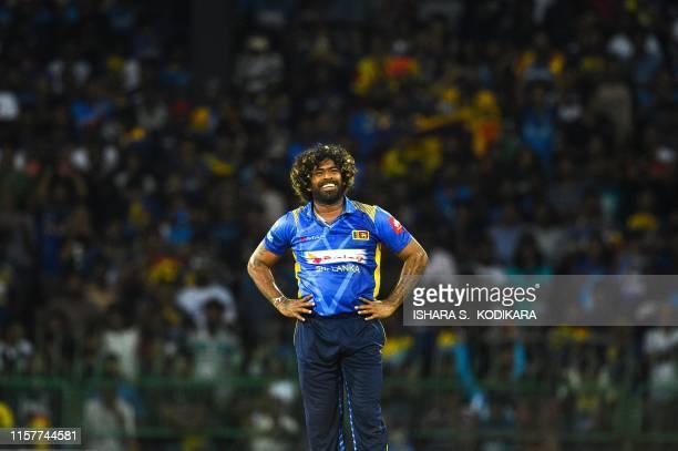 Sri Lankan cricketer Lasith Malinga looks on during the first One Day International cricket match between Sri Lanka and Bangladesh at the R.Premadasa...