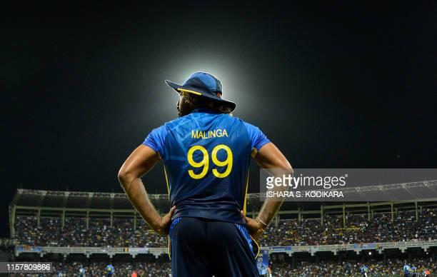 Sri Lankan cricketer Lasith Malinga looks on during the first One Day International cricket match between Sri Lanka and Bangladesh at the RPremadasa...