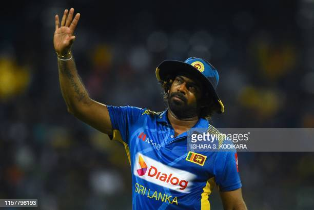 Sri Lankan cricketer Lasith Malinga waves to supporters during the first One Day International cricket match between Sri Lanka and Bangladesh at the...