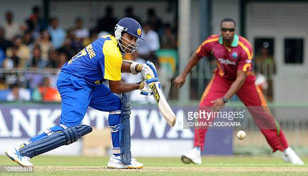 Sri Lankan cricketer Mahela Jayawardene plays a shot during the third One Day International cricket match between Sri Lanka and West Indies at the...