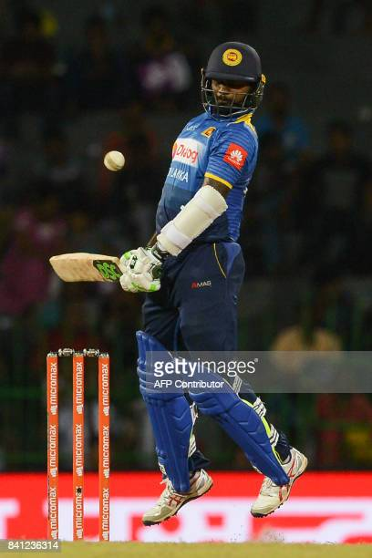 Sri Lankan cricketer Malinda Pushpakumara avoids a bouncer from Indian cricketer Jasprit Bumrah during the fourth one day international cricket match...