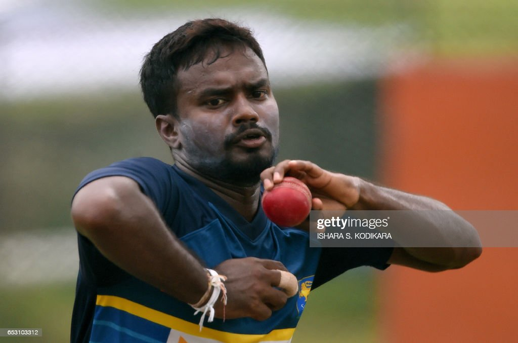 Sri Lankan cricketer Malinda Pushpakumara delivers a ball during a practice session at The P. Sara Oval Cricket Stadium in Colombo on March 14, 2017. Bangladesh play their 100th Test on March 15, against Sri Lanka at The P. Sara Oval Cricket Stadium in Colombo. / AFP PHOTO / Ishara S. KODIKARA
