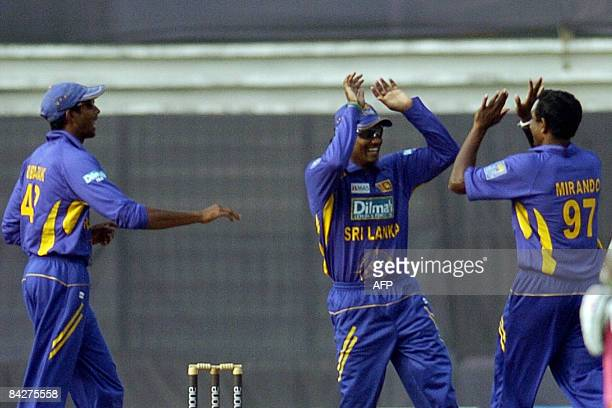 Sri Lankan cricketer Mirando celebrates with his teammates after the dismissal of Bangladeshi cricketer Mushfiqur Rahim during the 3rd match in the...