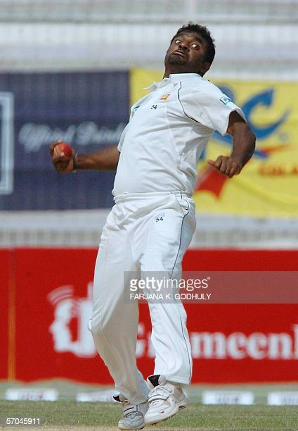 Sri Lankan cricketer Muttiah Muralitharan delivers a ball during the third day of the second Test Match between Bangladesh and Sri Lanka at The...
