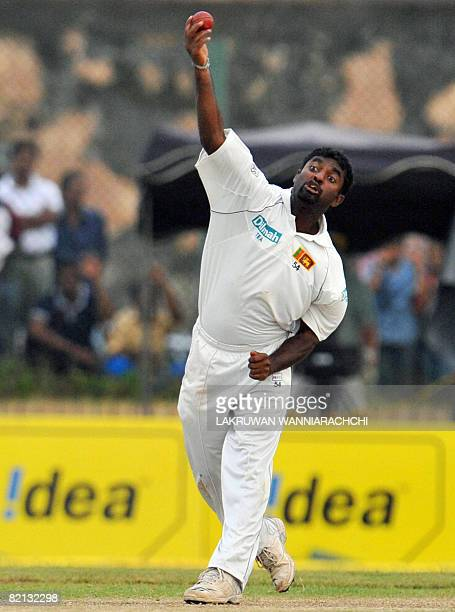Sri Lankan cricketer Muttiah Muralitharan delivers a ball during the first day of the second Test match between India and Sri Lanka at The Galle...