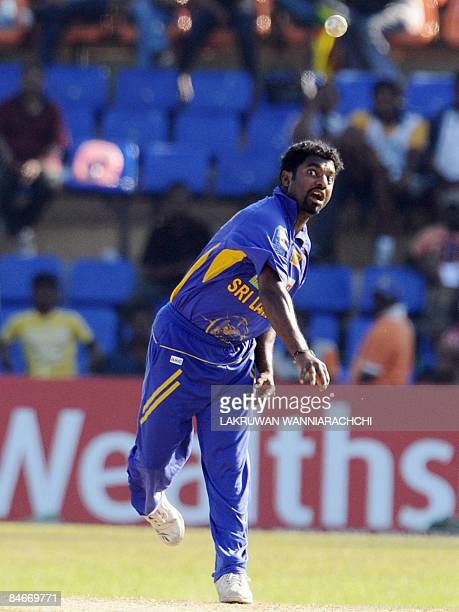 Sri Lankan cricketer Muttiah Muralitharan delivers the ball during the fourth One Day International match between India and Sri Lanka at the R...