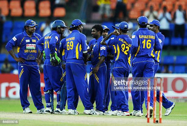 Sri Lankan cricketer Muttiah Muralitharan is congratulated by teammates after taking his 503rd One Day International wicket during the fourth One Day...