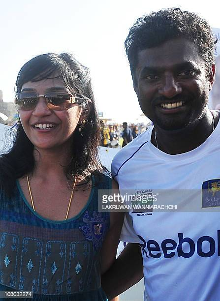 Sri Lankan cricketer Muttiah Muralitharan poses for a photo with his wife Madhimalar after his team won the first Test match between Sri Lanka and...