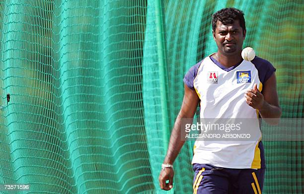 Sri Lankan cricketer Muttiah Muralitharan prepares to bowl during a team training session in Couva in central Trinidad and Tobago 13 March 2007 Sri...