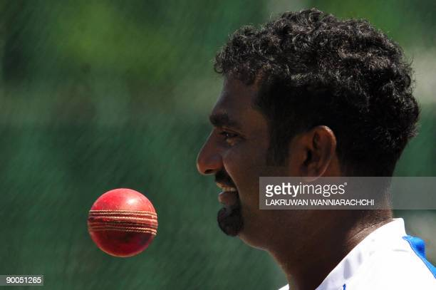 Sri Lankan cricketer Muttiah Muralitharan prepares to bowl during a practice session at The Sinhalese Sports Club grounds in Colombo on August 25,...