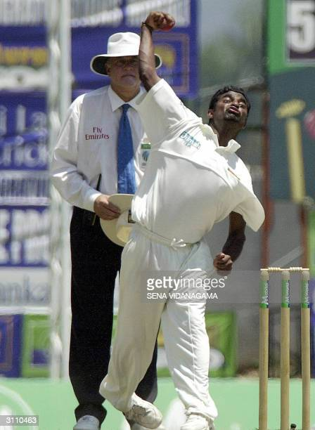 Sri Lankan cricketer Muttiah Muralitharan prepares to deliver a ball during the fourth day of the second Test match between Sri Lanka and Australia...