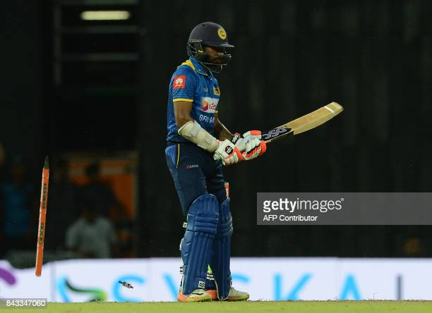 Sri Lankan cricketer Niroshan Dickwella is dismissed by Indian cricketer Jasprit Bumrah during the Twenty20 international cricket match between Sri...