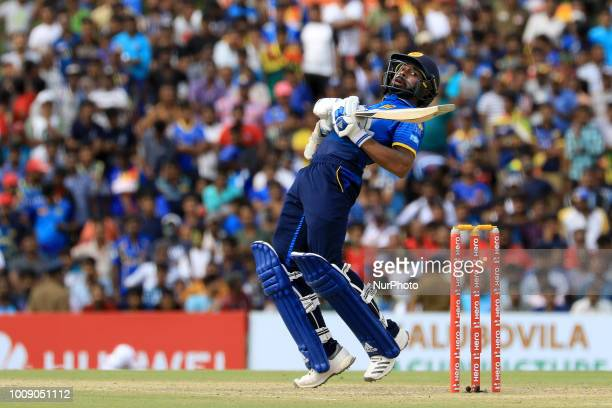 Sri Lankan cricketer Niroshan Dickwella plays a shot during the 2nd One Day International cricket match between Sri Lanka and South Africa at Rangiri...