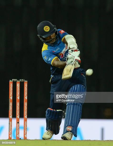 Sri Lankan cricketer Niroshan Dickwella plays a shot during the Twenty20 international cricket match between Sri Lanka and India at R Premadasa...
