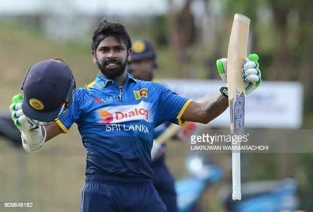 Sri Lankan cricketer Niroshan Dikwella celebrates after scoring a century during the third oneday international cricket match between Sri Lanka and...
