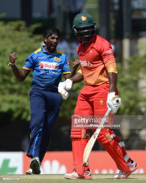 Sri Lankan cricketer Nuwan Pradeep celebrates after he dismissed Zimbabwe cricketer Solomon Mire during the third oneday international cricket match...