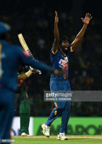 Sri Lankan cricketer Nuwan Pradeep celebrates after he dismissed Bangladesh cricketer Liton Das during the third Twenty20 international cricket match...