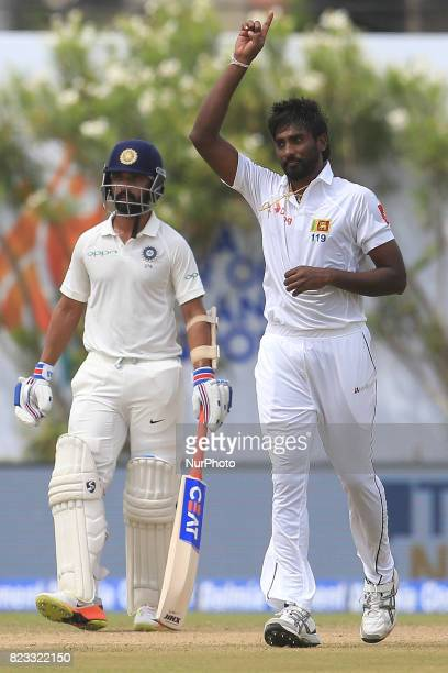 Sri Lankan cricketer Nuwan Pradeep celebrates after taking a wicket during the 2nd Day's play in the 1st Test match between Sri Lanka and India at...