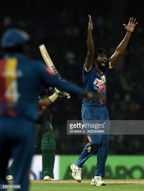 Sri Lankan cricketer Nuwan Pradeep celebrates the dismissal of Bangladeshi cricketer Liton Das during the third Twenty20 international cricket match...