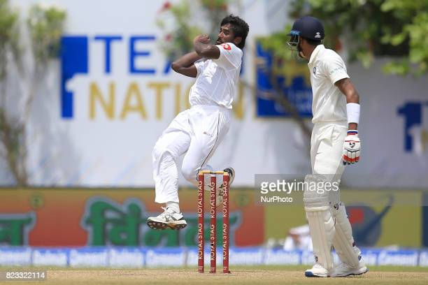 Sri Lankan cricketer Nuwan Pradeep leaps in the air while delivering a ball during the 2nd Day's play in the 1st Test match between Sri Lanka and...