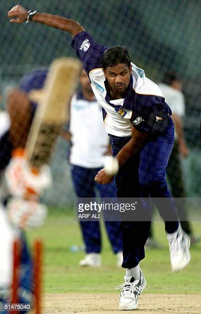 Sri Lankan cricketer Nuwan Zoysa delivers a ball during a net practice session at The Gaddafi Stadium in Lahore, 13 October 2004. Pakistan captain...