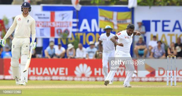 Sri Lankan cricketer Rangana Herath celebrates after taking a wicket during the 3rd day's play of the first test cricket match between Sri Lanka and...