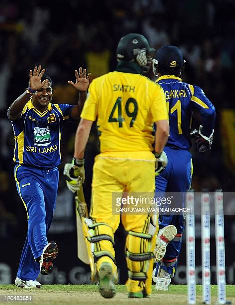 Sri Lankan cricketer Rangana Herath celebrates with his teammates after he dismissed Australian cricketer Steven Smith during the first Twenty20...