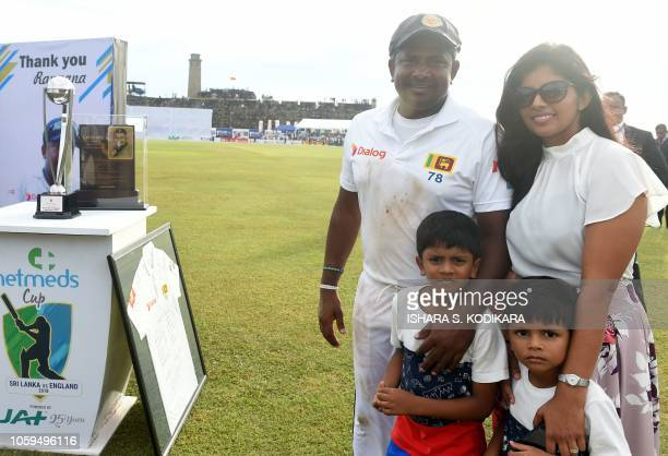 Sri Lankan cricketer Rangana Herath poses for photographers with his wife Senani and two sons after his last match where England won the opening Test...