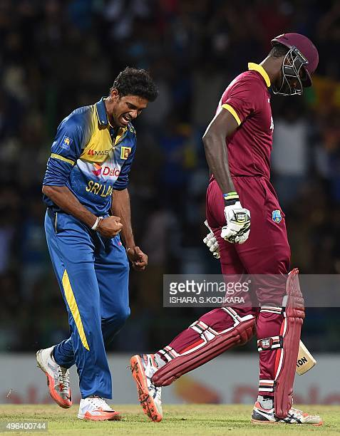 Sri Lankan cricketer Sachithra Senanayake celebrates after taking the wicket of West Indies cricketer Jason Holder during the first T20 International...