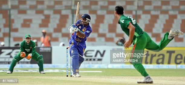 Sri Lankan cricketer Sanath Jayasuriya plays a stroke during a Super League Asia Cup match between Sri Lanka and Bangladesh at The National Stadium...
