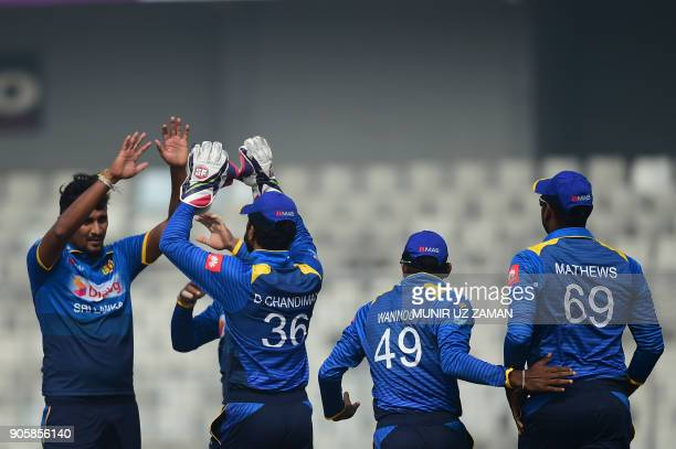 Sri Lankan cricketer Suranga Lakmal celebrates with teammates after the dismissal of Zimbabwe's Craig Ervine during the second One Day International...